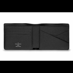 CLASSIC MULTIPLE WALLET TAIGA LEATHER By Vuitton